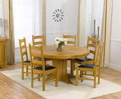 solid oak round dining table 6 chairs torino solid oak 150cm round pedestal dining table and 6 vermont
