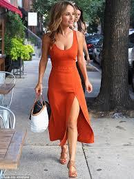 diadã me mariage giada de laurentiis turns up the heat in a low cut orange dress
