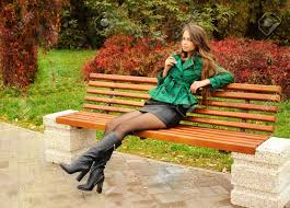 cute sitting on a bench in the park stock photo picture and