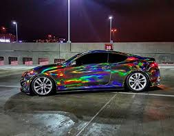 car wrapped in wrapping paper vvivid black holographic chrome vinyl wrap rainbow
