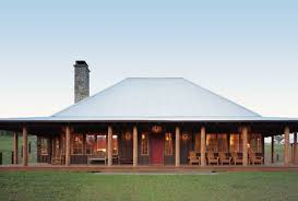 Farmhouse With Wrap Around Porch Neat Roof Elevation And Simplicity Of This Texas Ranch House The
