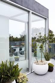 inside marysia swim founder u0027s glass and steel home cozy beach