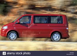 car volkswagen side view car vw volkswagen multivan t5 2 5 tdi van model year 2003 red