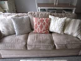 swoon style and home living room and dining room a softer color on the sofa i used some of the same pillows i also kept my cream textured pillow from target the oversized pillow on the right is from ballard designs