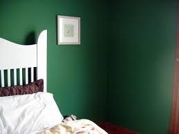 lovely dark green walls with old fashioned heavy dark wood trim