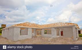 cement block walls wood roof truss home construction stock photo