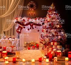 christmas interior xmas tree fireplace light decorated room stock