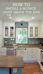 how to put lights above cabinets install a sconce light above the kitchen sink