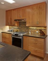 Kitchen Backsplash Cherry Cabinets by Shaker Craft Classic Natural Cherry Cabinetry With Black Quartz