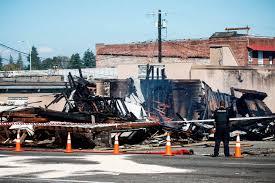 investigators probe smoldering rubble in downtown everett