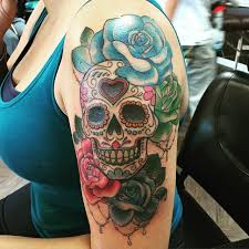 pink and blue with sugar skull on left half sleeve