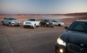 volkswagen jeep 2013 car and driver compares bmw u0027s e70 x5 with its main rivals