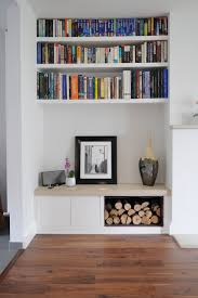 Alcove Log Storage And Book Shelves - Contemporary fitted living room furniture