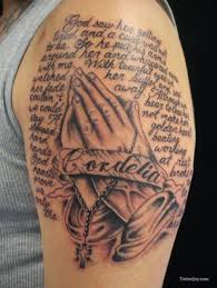 prayer hands holding a cross tattoo designs pictures to pin on