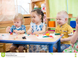 kids doing arts and crafts in day care centre stock photo image