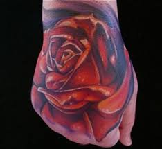 art junkies tattoo tattoos portrait color red rose hand tattoo