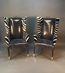 pair of modern wingback chairs in zebra printed cowhide and faux