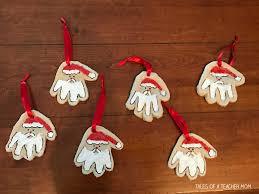 handprint santa ornaments tales of a