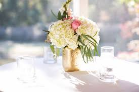 white floral arrangements pink and white flower arrangements in gold jars