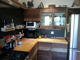 reclaimed wood kitchen cabinets barn siding gives these reclaimed