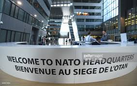 otan siege employees a welcome desk at the nato headquarters during a
