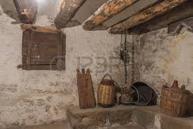 Basement Humidity - basement of an old house with wooden beams and wall with humidity