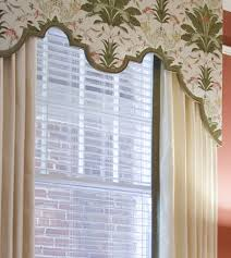 custom scalloped cornice board with drapery panels top