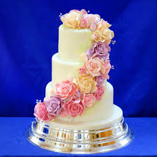 uby pre wedding cake decorated with cascading sugar roses in