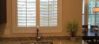 plantations shutters over a sink window cleveland shutters