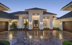 outdoor living takes center stage in this one story home with a