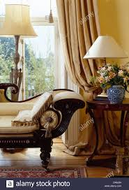 Antique Side Tables For Living Room Vintage Chaise Longue And Antique Side Table In Front Of Window