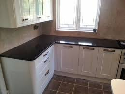 Microwave In Kitchen Cabinet by Granite Countertop Black Worktops For Kitchens How Do I Cook