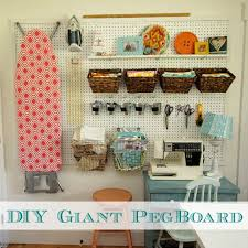 cool pegboard ideas how to install a diy giant pegboard wall craft room makeover