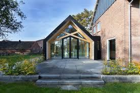 contemporary add on transforms this dutch 50s farmhouse freshome com