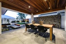 water feature outdoor dining table stone wall house in burns