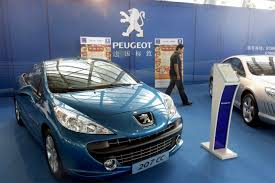 where is peugeot made peugeot maker says au revoir to nearly half of its sales in
