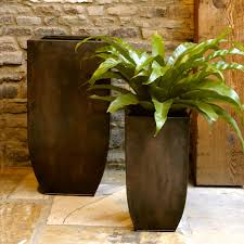 decor brick walls and tall outdoor planters with tile pavers for