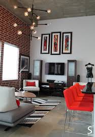 red interior design low seating living room loft modern eliving exposed brick wall