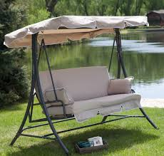 black metal patio swing with white fabric seat and canopy complete