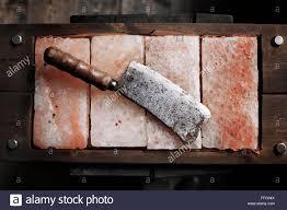 vintage meat cleaver on himalayan pink salt salt plates bars of
