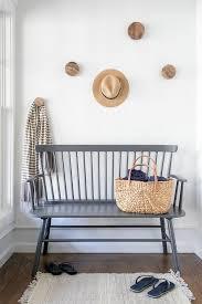 modern gray windsor bench with hat hooks cottage entrance foyer