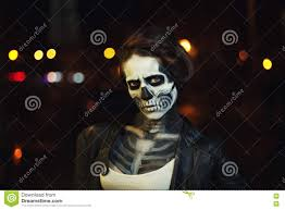 halloween night background young woman with halloween face art street portrait night city