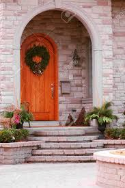 entrance of a luxury house with landscaping stock