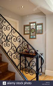 contemporary ornamental wrought iron banister and stained glass in