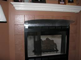 fireplace with homemade shield
