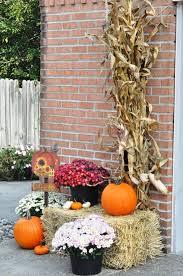 Outdoor fall decor mums hay bale pumpkins Harvest sign corn