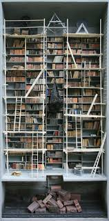 creepy miniature scenes recreate dusty libraries and forgotten