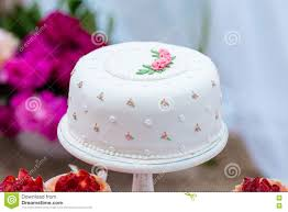 beautiful white wedding cake with flowers outdoor shabby chic