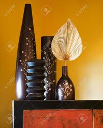 wholesale home interiors still of interior with asian vases on dresser stock photo
