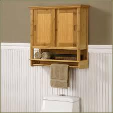 bathroom wall storage having dark brown wooden vanity cabinet